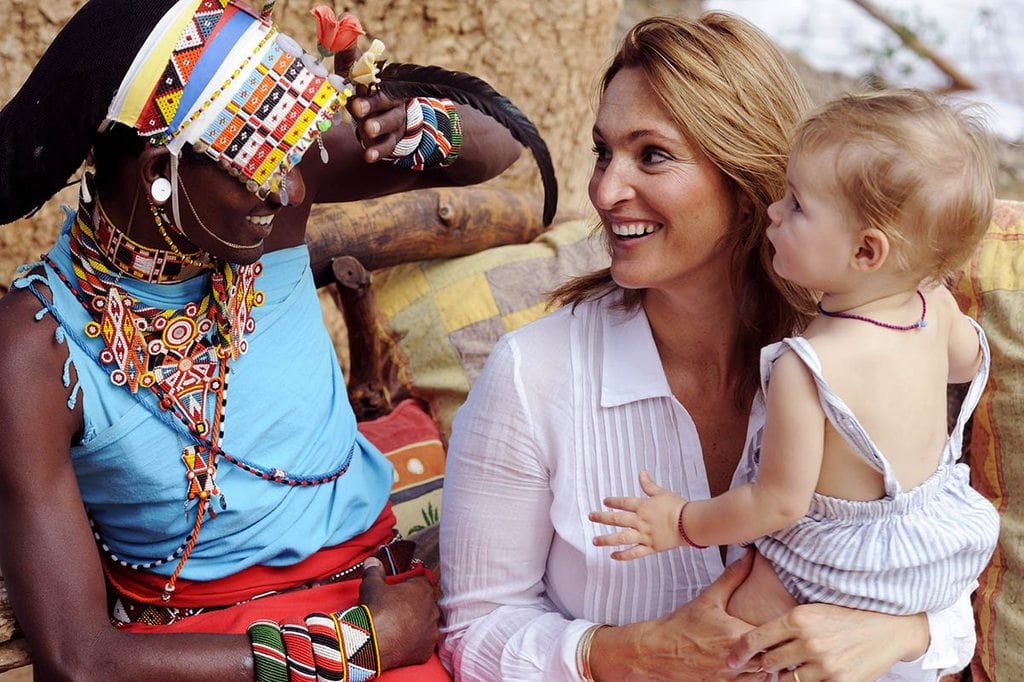 Remote tourists meeting indigenous East African people