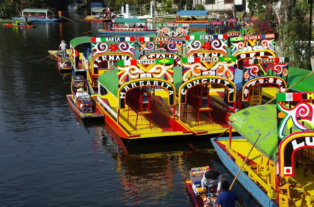 Colorful boats docked at the Xochimilco waterways