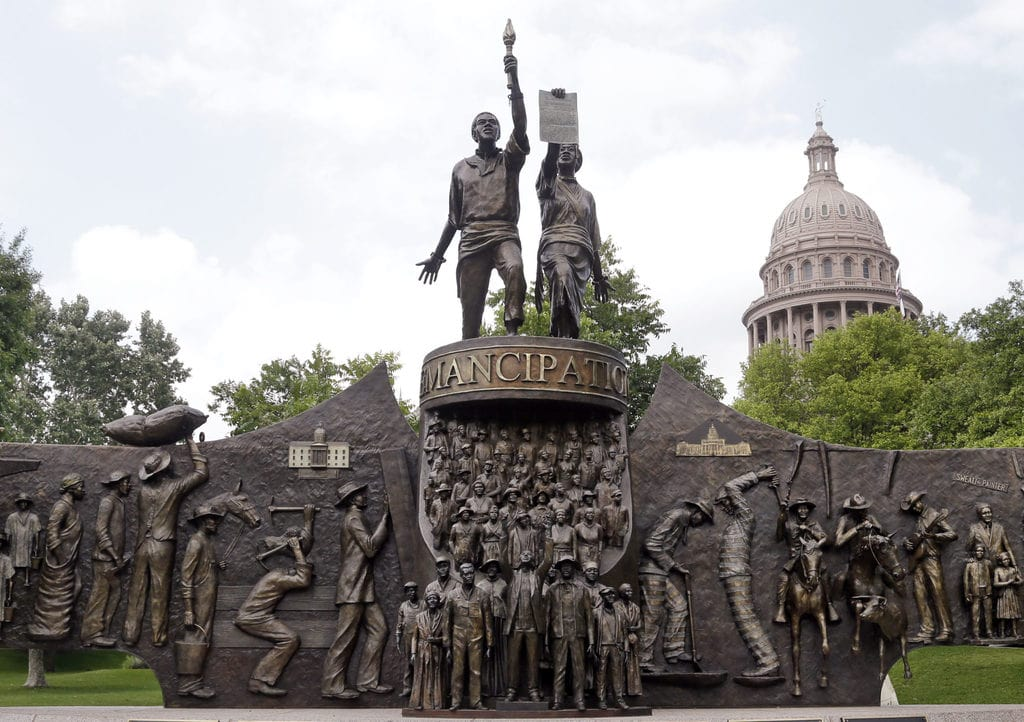 The Texas African American History Memorial with the Texas State Capitol in the background